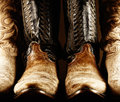 Old cowboy boots high contrast photo of several pairs of with the center pair being a matched pair Royalty Free Stock Image
