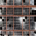Old building wall with dirty broken windows glass Royalty Free Stock Photo