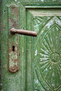 Old cracked color on door and door handle Royalty Free Stock Photography