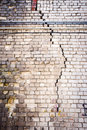 Old cracked white brick wall Royalty Free Stock Photo
