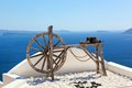 Old craftsmanship machine on the roof santorini island greece of building view caldera and aegean sea sunny day blue sky Stock Photography