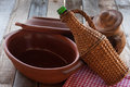 Old crocks with rattan bottle on table Royalty Free Stock Photos