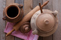 Old crocks with rolling pin and kitchen rag Stock Photo