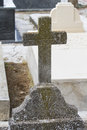 Old cross in a cemetery with graves spanish holy place Stock Photography