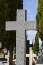 Old cross in a cemetery with graves spanish holy place Royalty Free Stock Photo
