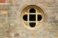 Old cross in stone window Royalty Free Stock Photo