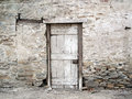 Old Crumbling Rock Wall with a Door. Royalty Free Stock Photo