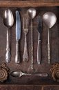 Old cutlery in a old wooden box Royalty Free Stock Images