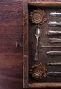Old cutlery in a old wooden box Stock Photos