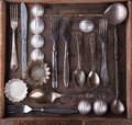 Old cutlery in a wooden box top view Stock Image