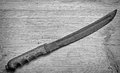Old dagger monochrome grunge long on wooden board Stock Photography