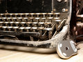Old dark typewriter with modern mouse Royalty Free Stock Photo