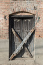 Old decayed wooden door closed Royalty Free Stock Photography