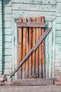 Old decayed wooden door and wall Stock Photos