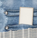 Old denim background with paper frame Royalty Free Stock Photo