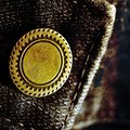 Old denim pants button pair of with detail of brass and seams Stock Photos