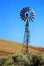 Old dependable energy an windmill still being used to generate and pull water up in the pioneer cowboy era in western american Stock Photos