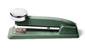 Old desk stapler green from the s isolated on white Stock Photography