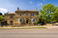 Old detached town house on broadway high street cotswold country worcestershire uk Stock Photos