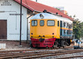 Old diesel hydraulic locomotive near the control house of railwayyard Stock Photography