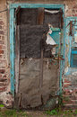 Old dilapidated ragged door Royalty Free Stock Photos