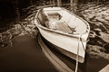 Old dinghy in sepia style and image Royalty Free Stock Photos