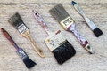 Old dirty grunge paintbrushes on dirty rusty wooden background Royalty Free Stock Photo
