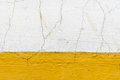 Old dirty wall with cracked yellow paint and plaster Royalty Free Stock Photo