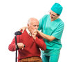 Old disabled man hand kiss nurse home care Royalty Free Stock Photos