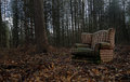 An old discarded Chair is dump illegaly in the middle of a woodland. Royalty Free Stock Photo