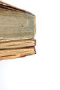 Old discoloured books pile of three vintage with worn pages partial view isolated on white Stock Images