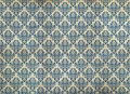 Old distressed blue damask wallpaper Stock Image