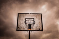 Old disused outdoor basketball hoop Royalty Free Stock Photo