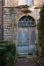Old door an ancient of the medieval village of puycelsi in france Royalty Free Stock Photos