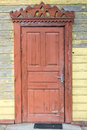 Old door brown in a wooden building Royalty Free Stock Images