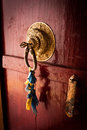 Old door at buddhist monastery temple india decorated with ancient doorknob and tassel ladakh spituk gompa Stock Photo