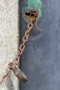Old door chained shut with vintage padlock Royalty Free Stock Photo