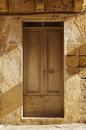 Old door close up of an wooden on a stone building Royalty Free Stock Photo