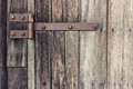 Old door closeup with antique rust hinge Stock Photos