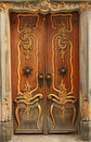 Old door with gold ornaments Royalty Free Stock Photo