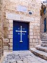 Old door with a greek orthodox cross the view of the church in the city of jaffa israel Stock Photos