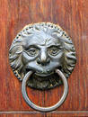 Old door handle close-up in Toscany, Italy. Royalty Free Stock Photo