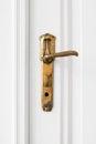 Old door handle  on white door Royalty Free Stock Photo