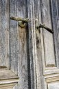 Old door handles decorated on weathered doors Stock Photo