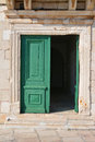 Old door in hvar croatia home entrance with green Stock Image