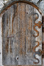Old door with iron hinges an wooden rusty and handle Stock Image