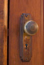 Old door knob brass with key hole Stock Photo