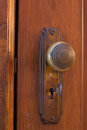 Old door knob with key brass inside the keyhole Stock Photos
