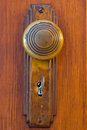 Old Door knob with key Royalty Free Stock Photo