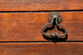 Old door knocker wood wall Stock Photography